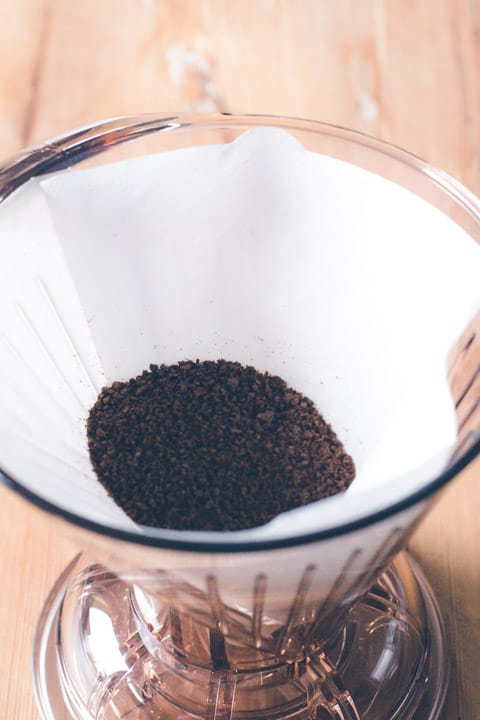 clever dripper coffee maker with paper filter and scoop of coffee grounds inside