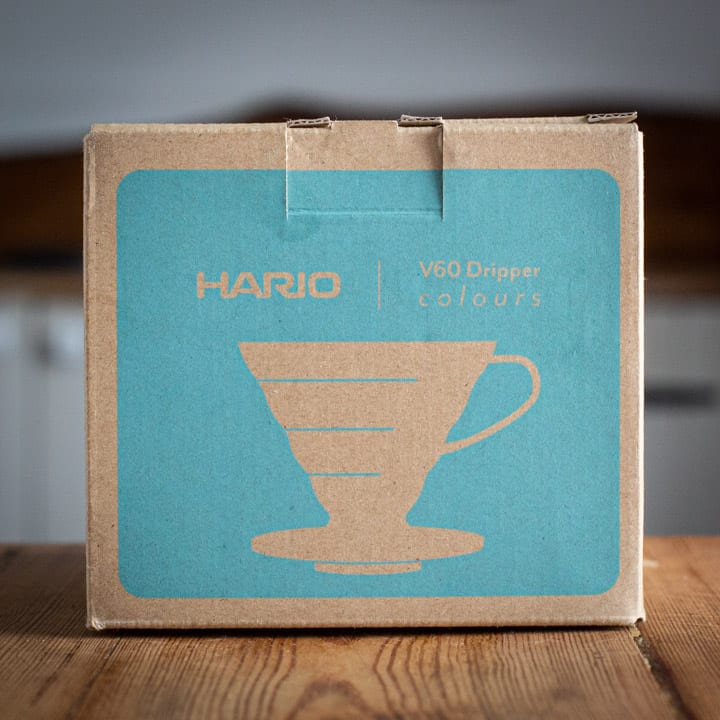 brown and turquoise box for the Hario v60 coffee maker on wooden surface