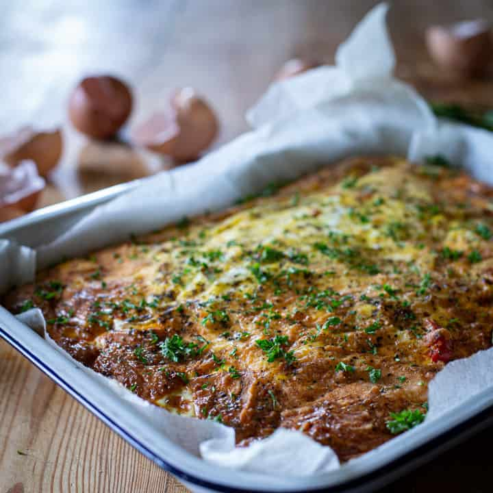 warm chorizo frittata on a wooden surface