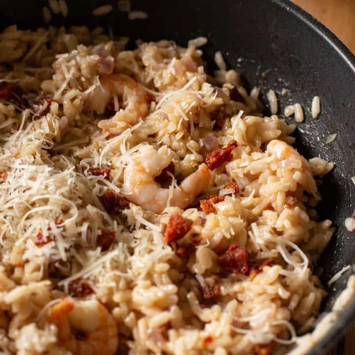 juicy pink prawn in a pan of chorizo risotto