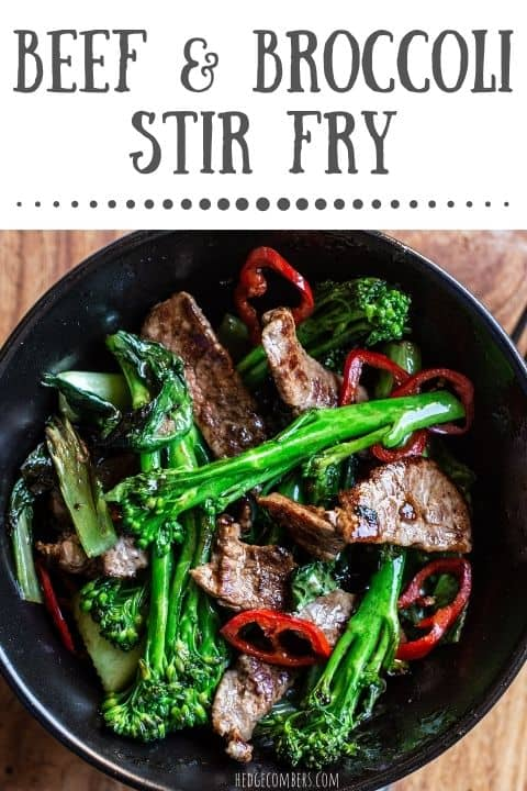 black bowl with bright green broccolini charred sirloin steak strips and rings of red chilli